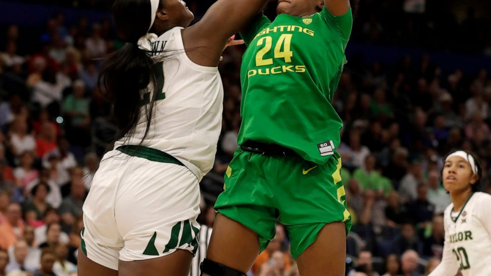 Baylor center Kalani Brown (21) blocks a shot by Oregon forward Ruthy Hebard (24) during the first half of a Final Four semifinal of the NCAA women's college basketball tournament Friday, April 5, 2019, in Tampa, Fla. (AP Photo/Chris O'Meara)