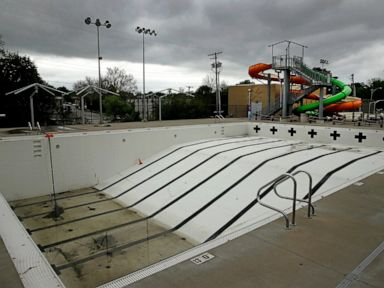 US communities face tough choices on opening public pools