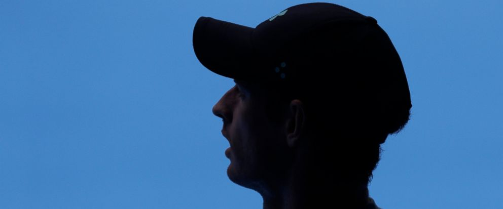 Britains Andy Murray waits in the shade during his practice match against Serbias Novak Djokovic on Margaret Court Arena ahead of the Australian Open tennis championships IN Melbourne, Australia, Thursday, Jan. 10, 2019. (AP Photo/Mark Baker)