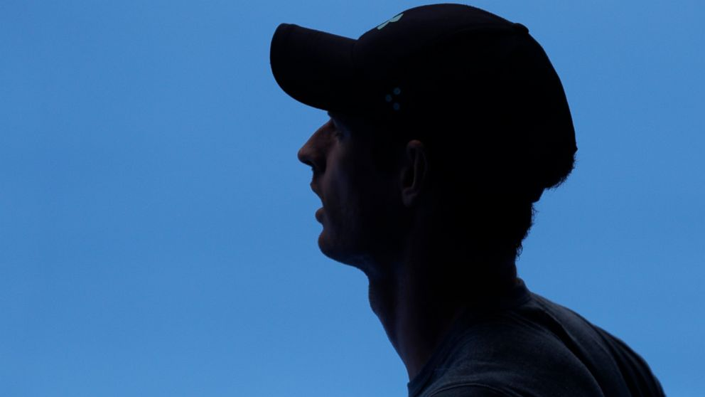 Britain's Andy Murray waits in the shade during his practice match against Serbia's Novak Djokovic on Margaret Court Arena ahead of the Australian Open tennis championships IN Melbourne, Australia, Thursday, Jan. 10, 2019. (AP Photo/Mark Baker)