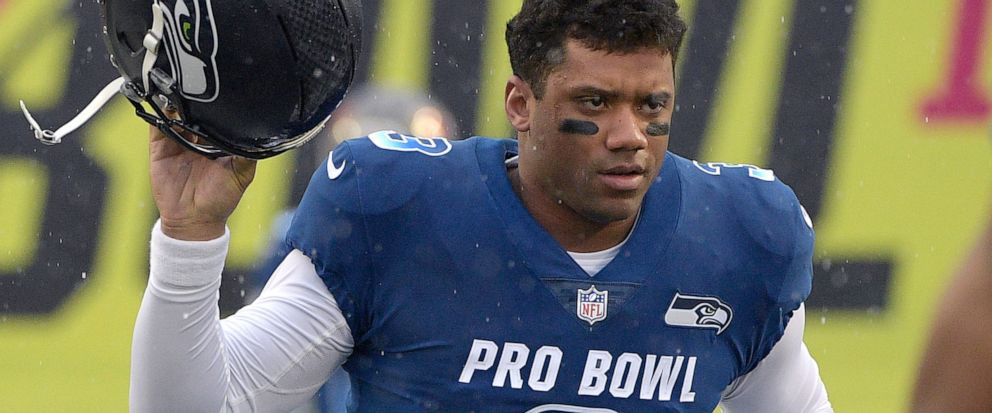 FILE - In this Jan. 27, 2019, file photo, NFC quarterback Russell Wilson of the Seattle Seahawks runs onto the field during player introductions before the NFL Pro Bowl football game against the AFC in Orlando, Fla. Wilson posted a video to social me