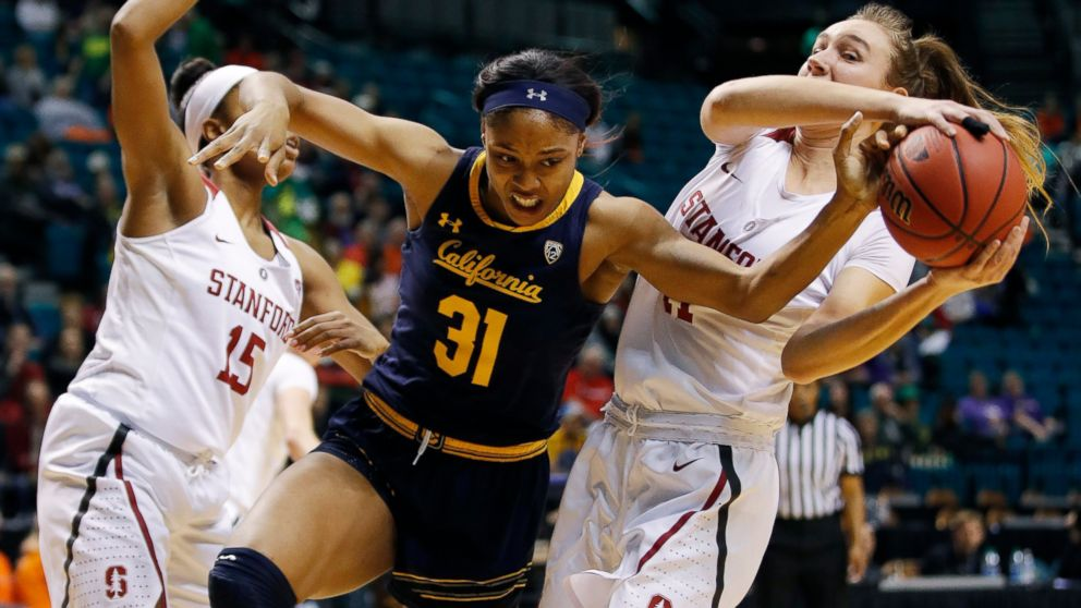 Stanford's Maya Dodson, left, and Alanna Smith, right, battle for the ball with California's Kristine Anigwe during the first half of an NCAA college basketball game at the Pac-12 women's tournament Friday, March 8, 2019, in Las Vegas. (AP Photo/John Locher)