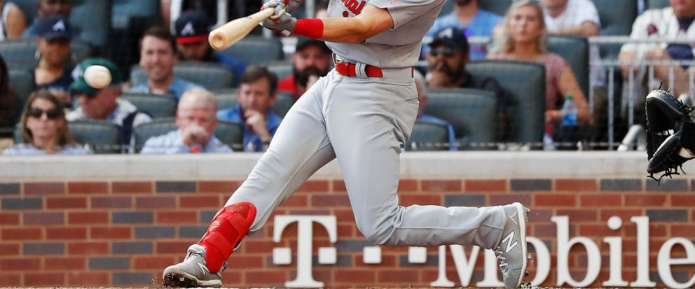 St. Louis Cardinals Tommy Edman doubles to score teammates Marcell Ozuna and Yadier Molina during the first inning of Game 5 of their National League Division Series baseball game against the Atlanta Braves, Wednesday, Oct. 9, 2019, in Atlanta. (AP
