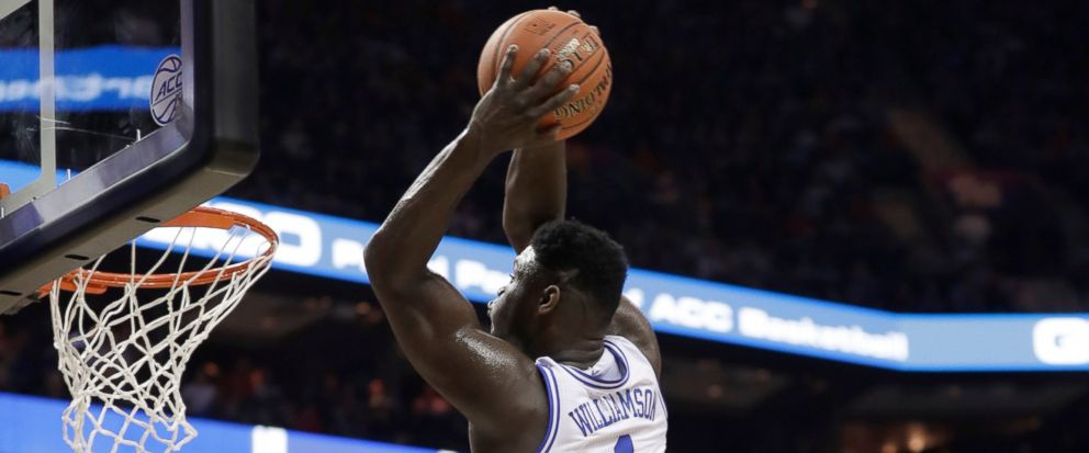 Dukes Zion Williamson (1) goes up to dunk against Syracuse during the first half of an NCAA college basketball game in the Atlantic Coast Conference tournament in Charlotte, N.C., Thursday, March 14, 2019. (AP Photo/Nell Redmond)