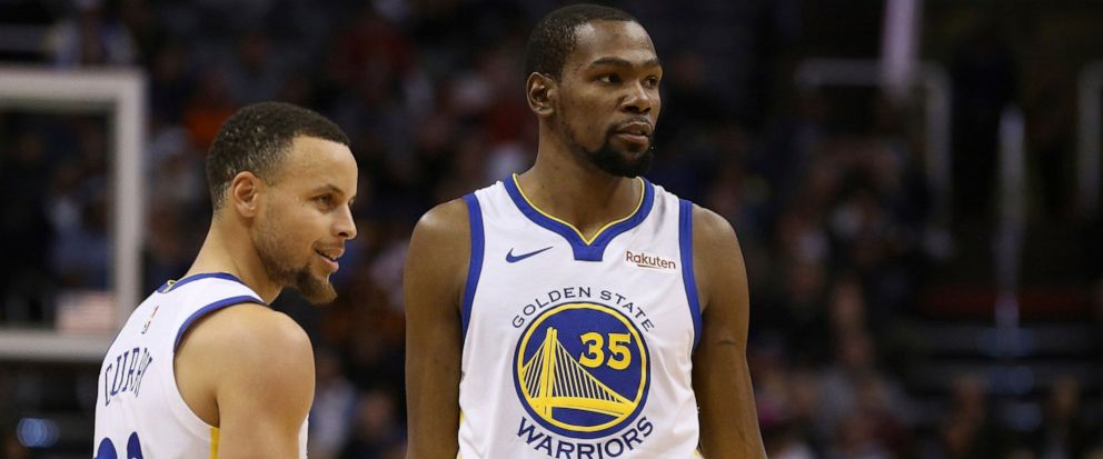 FILE - In this Feb. 8, 2019, file photo, Golden State Warriors guard Stephen Curry (30) and forward Kevin Durant (35) pause during the first half of an NBA basketball game against the Phoenix Suns Friday, Feb. 8, 2019, in Phoenix. Someday, years or e