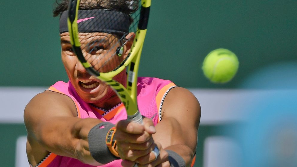 """FILE - In this Friday, March 15, 2019 file photo, Spain's Rafael Nadal hits a return to Russia's Karen Khachanov at the BNP Paribas Open tennis tournament, in Indian Wells, Calif. The second-ranked Spaniard Nadal is making his latest comeback at the Monte Carlo Masters, April 13-21, """"It has been a tough year and a half for me, so it's tough to have a clear view about how I am,"""" Nadal said Monday April 15, 2019, at the tournament. (AP Photo/Mark J. Terrill, file)"""