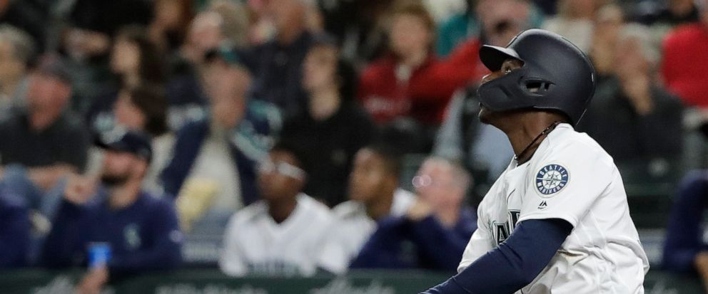 Seattle Mariners Kyle Lewis watches his three-run home run against the Cincinnati Reds during the seventh inning of a baseball game Wednesday, Sept. 11, 2019, in Seattle. Lewis ended a no-hit bid by Reds starting pitcher Sonny Gray. (AP Photo/Ted S.