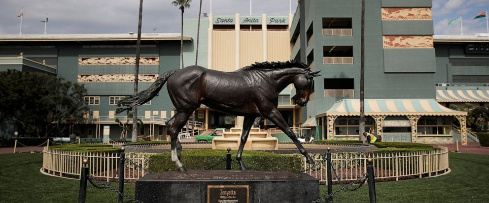 FILE - In this March 5, 2019, file photo, a statue of Zenyatta stands in the paddock gardens area at Santa Anita Park in Arcadia, Calif. California Gov. Gavin Newsom is supporting a state Senate bill that would give the California Horse Racing Board