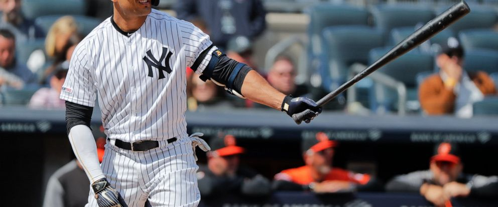 FILE - In this Saturday, March 30, 2019 file photo, New York Yankees right fielder Giancarlo Stanton waits for the pitch against the Baltimore Orioles during the fourth inning of a baseball game in New York. Giancarlo Stanton wants to return from his