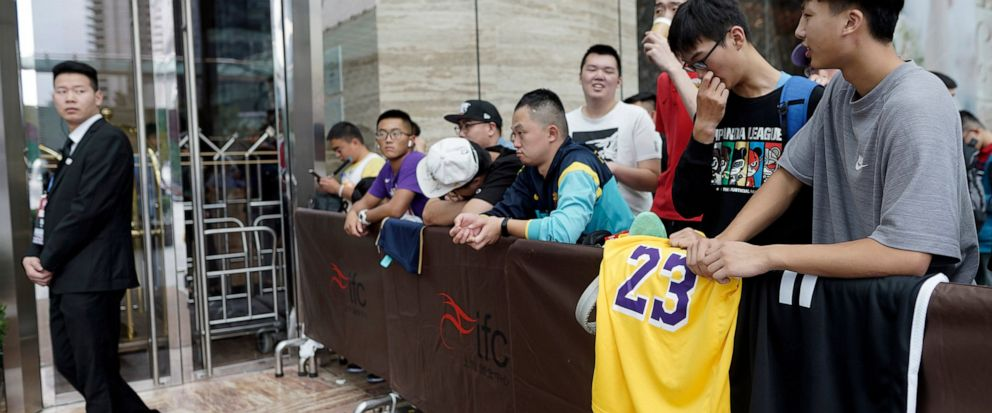 Chinese basketball fans gather outside of a hotel for a press conference that was later postponed ahead of an NBA preseason basketball game on Thursday between the Los Angeles Lakers and Brooklyn Nets in Shanghai, China, Wednesday, Oct. 9, 2019. The