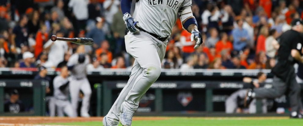 New York Yankees Gleyber Torres rounds the bases after a run home run during the sixth inning in Game 1 of baseballs American League Championship Series against the Houston Astros Saturday, Oct. 12, 2019, in Houston. (AP Photo/Matt Slocum)