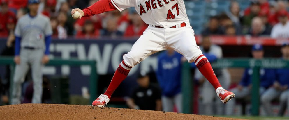 ae1a8aebfaa Los Angeles Angels starting pitcher Griffin Canning throws to a Toronto  Blue Jays batter during the