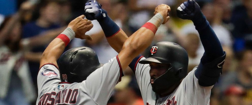 Minnesota Twins Marwin Gonzalez celebrates with Eddie Rosario after hitting a three-run home run during the eighth inning of a baseball game against the Milwaukee Brewers Tuesday, Aug. 13, 2019, in Milwaukee. (AP Photo/Morry Gash)