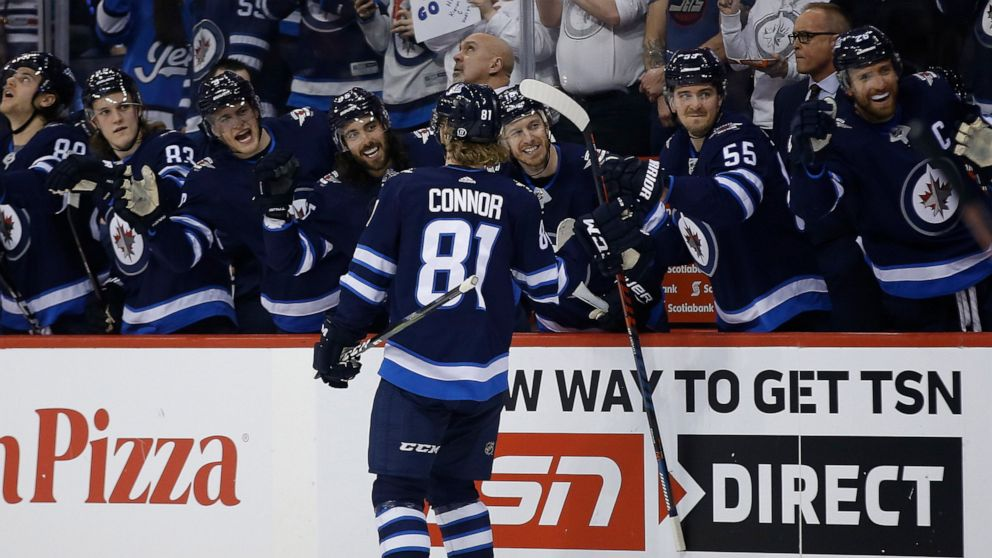 Connor S Hat Trick Helps Jets Top Preds Clinch Playoff Spot Abc News