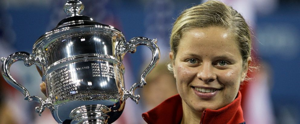 FILE - In this Sept. 13, 2009, file photo, Kim Clijsters holds the trophy after winning the womens championship over Caroline Wozniacki, at the U.S. Open tennis tournament in New York. Four-time Grand Slam champion Kim Clijsters is planning another