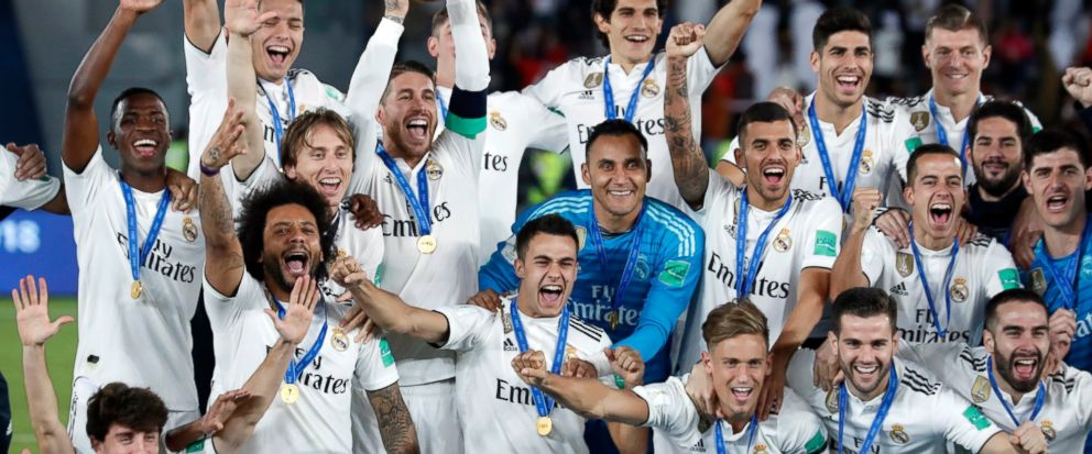 FILE - In this Saturday, Dec. 22, 2018 file photo, Real Madrid players celebrate with the trophy after winning the Club World Cup at Zayed Sport City in Abu Dhabi, United Arab Emirates. FIFA Council members will be asked on Friday March 15, 2019, to