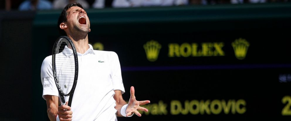 Serbias Novak Djokovic reacts as he plays against Spains Roberto Bautista Agut in a Mens singles semifinal match on day eleven of the Wimbledon Tennis Championships in London, Friday, July 12, 2019. (Carl Recine/Pool Photo via AP)