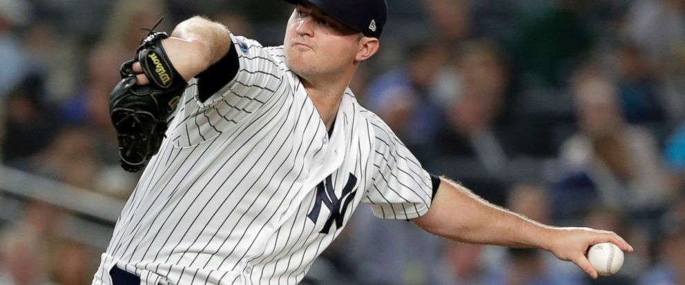 FILE - In this Tuesday, Oct. 9, 2018 file photo, New York Yankees relief pitcher Zach Britton delivers against the Boston Red Sox during the fourth inning of Game 4 of baseballs American League Division Series in New York. A person familiar with the