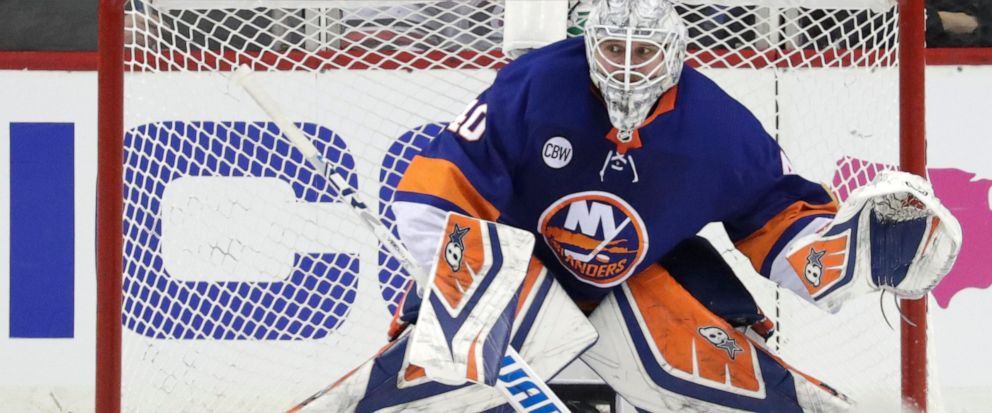FILE - In this April 26, 2019 file photo New York Islanders goaltender Robin Lehner, of Sweden, defends his net against the Carolina Hurricanes during the second period of Game 1 of an NHL hockey second-round playoff series in New York. Lehner agreed
