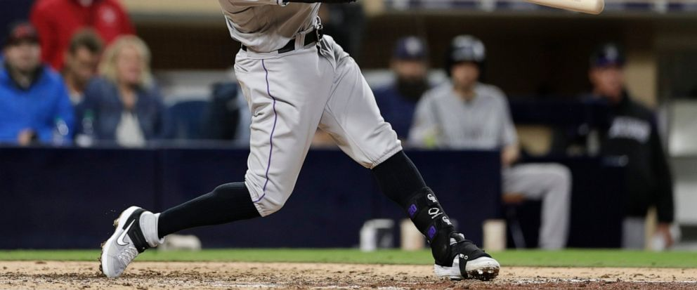 Colorado Rockies Ian Desmond hits a home run during the seventh inning of a baseball game against the San Diego Padres, Monday, April 15, 2019, in San Diego. (AP Photo/Gregory Bull)