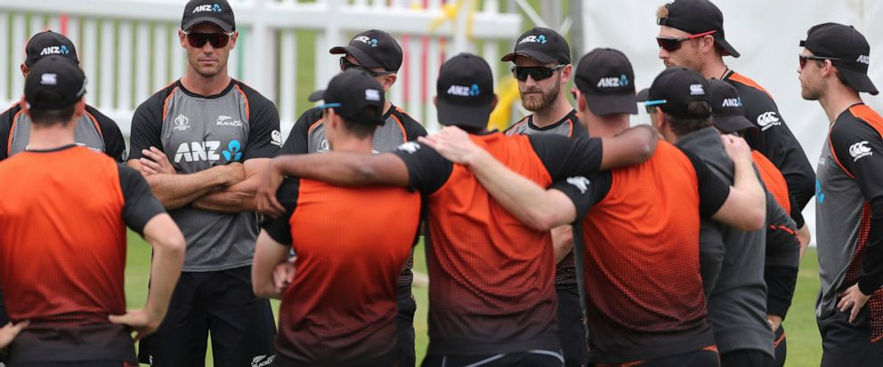 New Zealands captain Kane Williamson, center right facing camera, stands with teammates during a training session ahead of the Cricket World Cup final match against England at Lords cricket ground in London, England, Saturday, July 13, 2019. (AP Ph