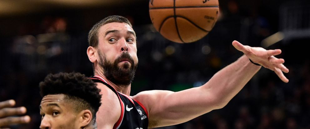 Toronto Raptors center Marc Gasol (33) throws a pass as Milwaukee Bucks forward Giannis Antetokounmpo (34) defends during the second half of Game 2 of the NBA basketball playoffs Eastern Conference finals, Friday, May 17, 2019, in Milwaukee. (Frank G