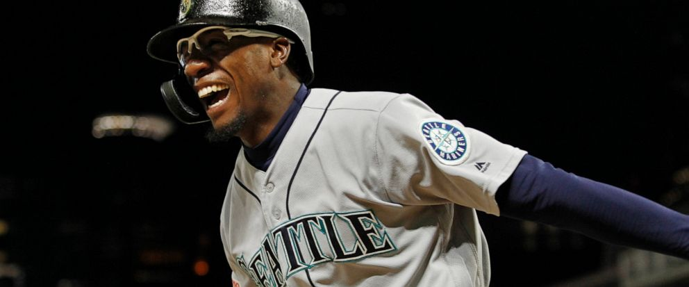 Seattle Mariners Shed Long celebrates his three-run home run against the Minnesota Twins during the eighth inning of a baseball game Wednesday, June 12, 2019, in Minneapolis. (AP Photo/Bruce Kluckhohn)