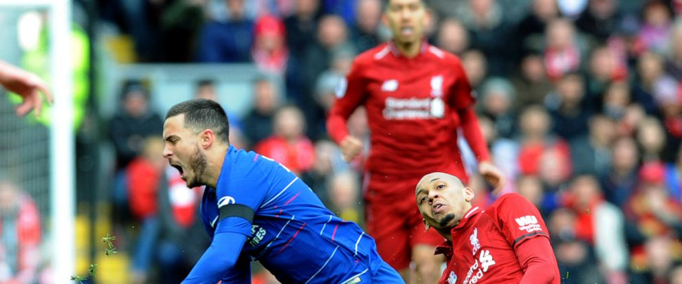Chelseas Eden Hazard, left, duels for the ball with Liverpools Fabinho during the English Premier League soccer match between Liverpool and Chelsea at Anfield stadium in Liverpool, England, Sunday, April 14, 2019. (AP Photo/Rui Vieira)