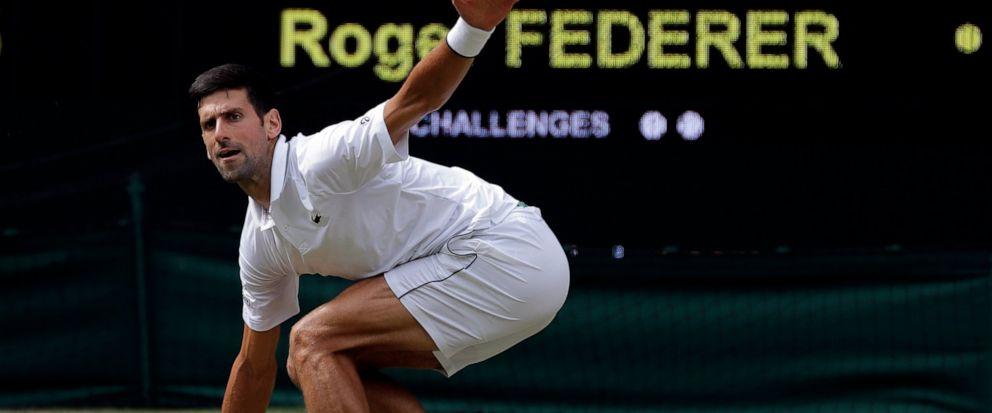 Serbias Novak Djokovic plays a shot to Switzerlands Roger Federer during the mens singles final match of the Wimbledon Tennis Championships in London, Sunday, July 14, 2019. (AP Photo/Ben Curtis)