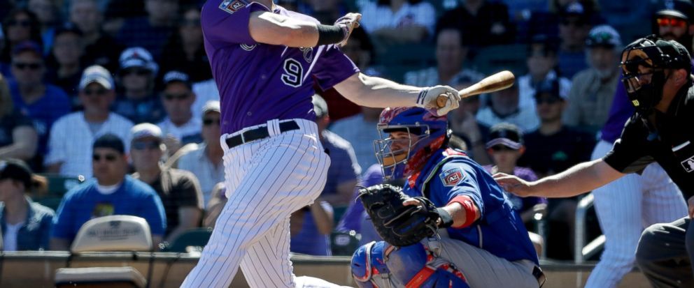 FILE - In this March 5, 2018, file photo, Colorado Rockies DJ LeMahieu bats during a spring baseball game against the Chicago Cubs, in Scottsdale, Ariz. A person familiar with the negotiations tells The Associated Press that Gold Glove-winning free