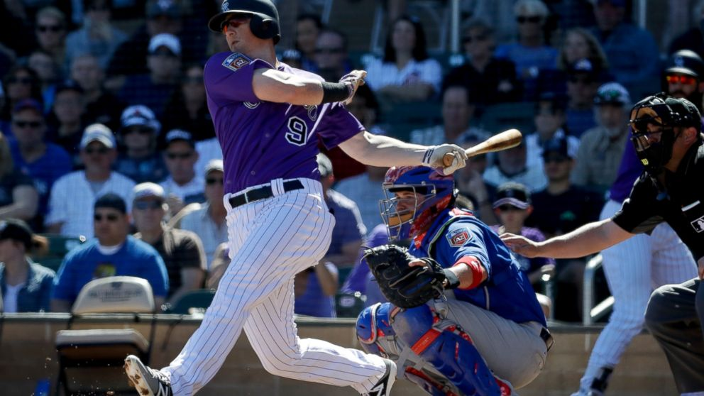 FILE - In this March 5, 2018, file photo, Colorado Rockies' DJ LeMahieu bats during a spring baseball game against the Chicago Cubs, in Scottsdale, Ariz. A person familiar with the negotiations tells The Associated Press that Gold Glove-winning free agent second baseman D.J. LeMahieu and the Yankees are nearing agreement on a two-year contract, a deal that would appear to eliminate New York as a destination for Manny Machado. The person spoke on condition of anonymity Friday, Jan. 11, 2019, because no agreement had been announced. (AP Photo/Chris Carlson, File)