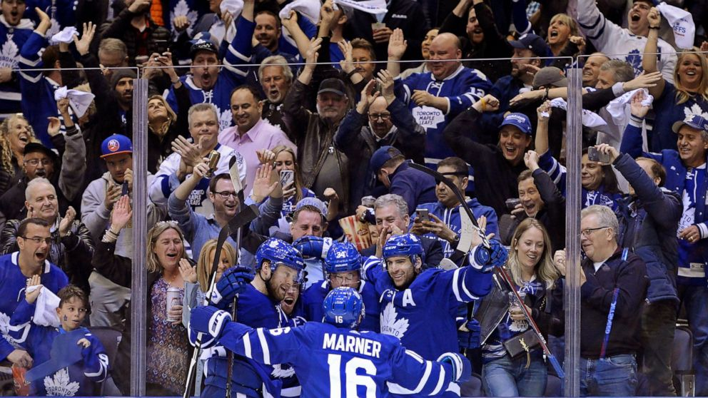 Toronto Maple Leafs center Auston Matthews (34) celebrates his goal against the Boston Bruins with teammates during the second period of an NHL playoff hockey game in Toronto on Monday, April 15, 2019. (Nathan Denette/The Canadian Press via AP)