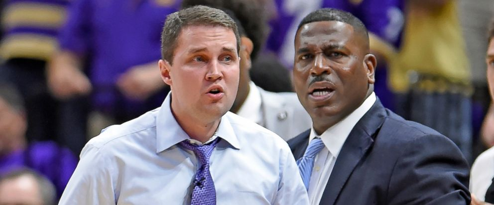 In this photo taken Feb. 23, 2019, LSU head coach Will Wade, left, and assistant coach Tony Benford, right, watch the second half of an NCAA college basketball game in Baton Rouge, La. Benford has been named interim head coach after Wade was suspende