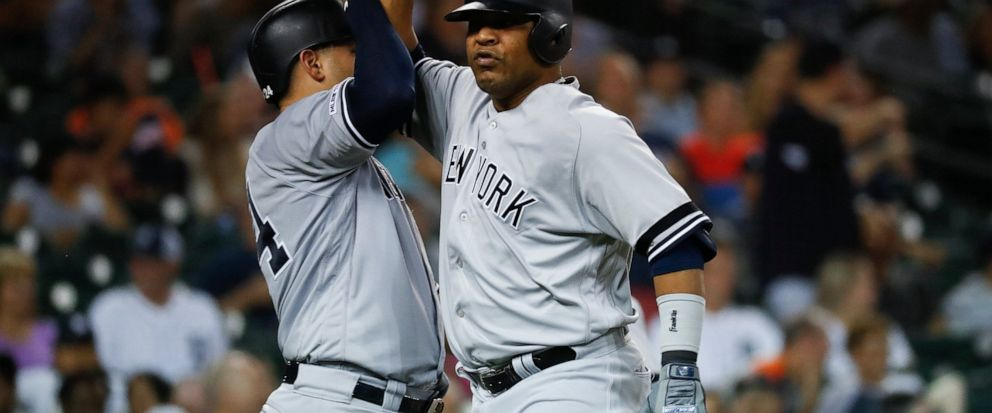 New York Yankees Edwin Encarnacion, right, celebrates his two-run home run with New York Yankees Gary Sanchez in the seventh inning of a baseball game against the Detroit Tigers in Detroit, Tuesday, Sept. 10, 2019. (AP Photo/Paul Sancya)