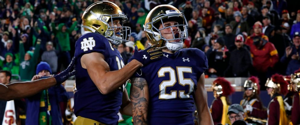 Notre Dame wide receiver Braden Lenzy (25) celebrates his 51-yard touchdown run with Chris Finke (10) in the first half of an NCAA college football game against Southern California in South Bend, Ind., Saturday, Oct. 12, 2019. (AP Photo/Paul Sancya)