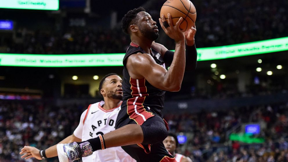 Heat playoff hopes take a hit with OT loss in Toronto ...