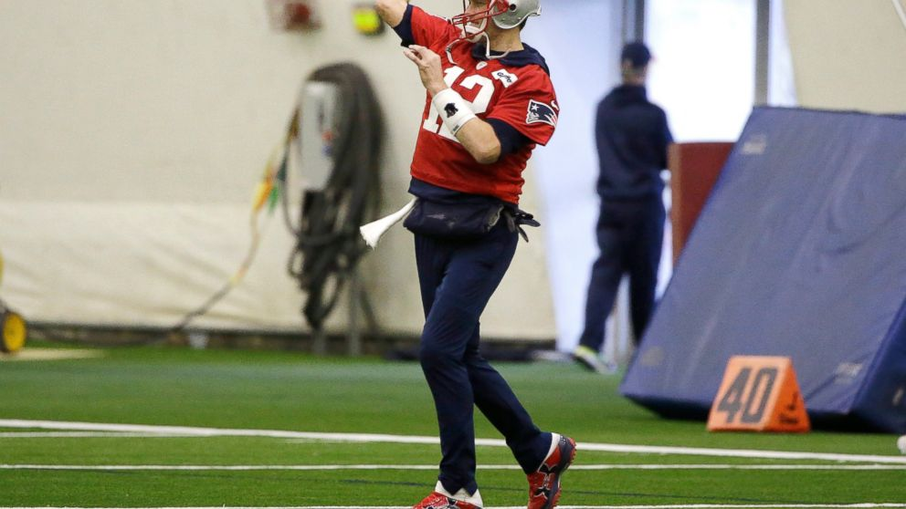New England Patriots quarterback Tom Brady (12) warms up during an NFL  football practice f29071b0e