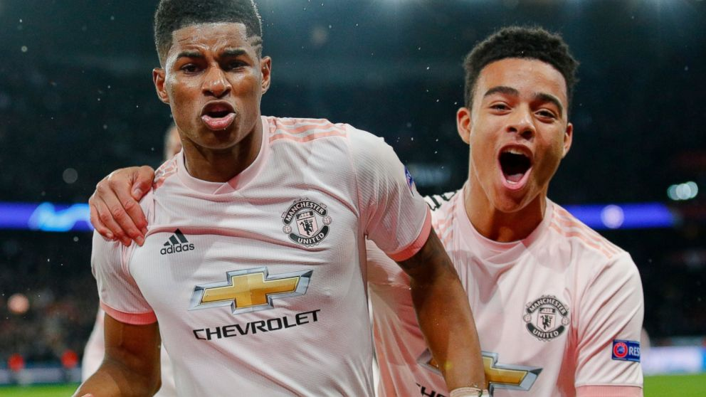ManU's Marcus Rashford, left, celebrates after scoring his side's third goal during the Champions League round of 16, second leg soccer match between Paris Saint Germain and Manchester United at the Parc des Princes stadium in Paris, France, Wednesday, March. 6, 2019. (AP Photo/Francois Mori)