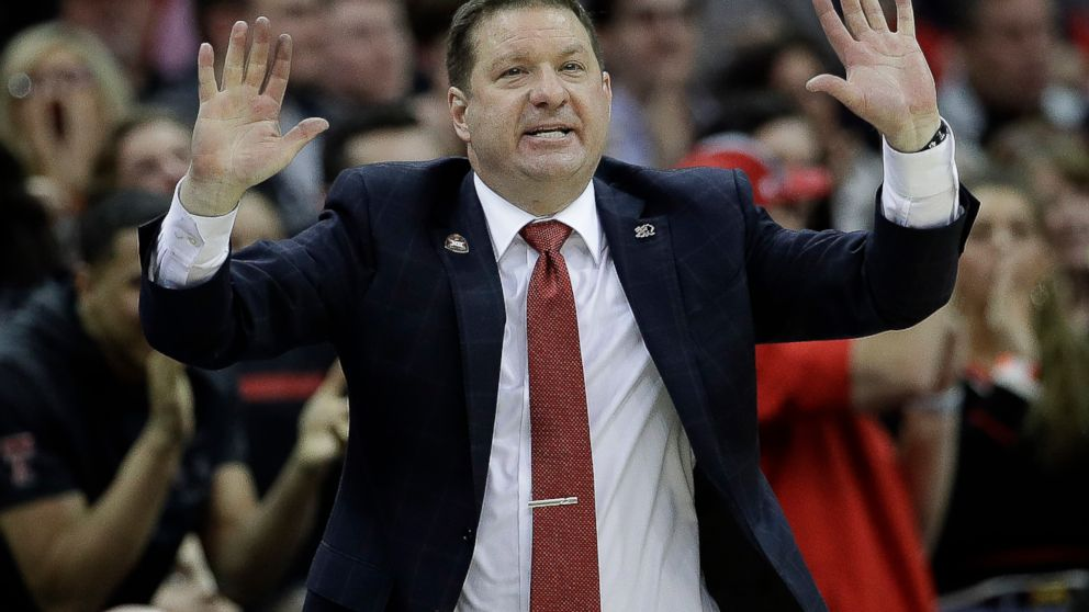 Texas Tech coach Chris Beard talks to his team during the second half of an NCAA college basketball game against West Virginia in the Big 12 men's tournament Thursday, March 14, 2019, in Kansas City, Mo. West Virginia won 79-74. (AP Photo/Charlie Riedel)