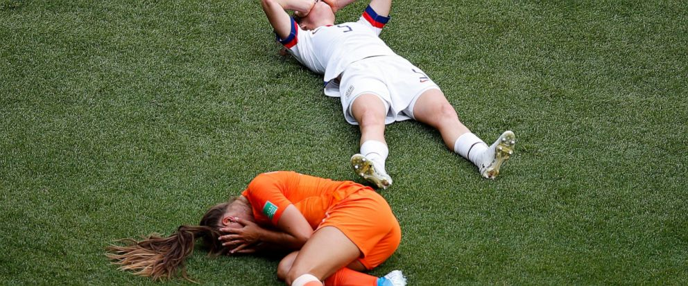 Netherlands Lieke Martens and United States Kelley O Hara lie on the pitch during the Womens World Cup final soccer match between US and The Netherlands at the Stade de Lyon in Decines, outside Lyon, France, Sunday, July 7, 2019. (AP Photo/Francoi