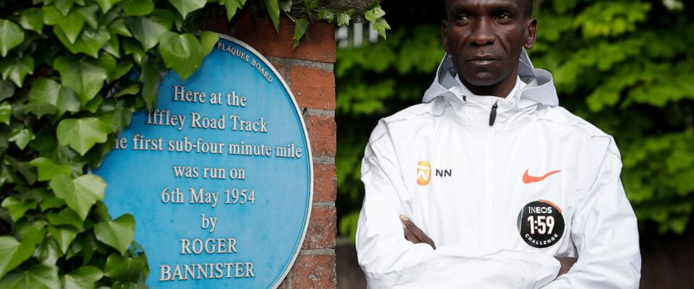 FILE - In this Tuesday, April 30, 2019 file photo, marathon world record holder Kenyas Eliud Kipchoge poses for photographers at the Iffley Road Track, in Oxford, England. Kipchoge's attempt to run a sub two-hour marathon has been set for Saturday,