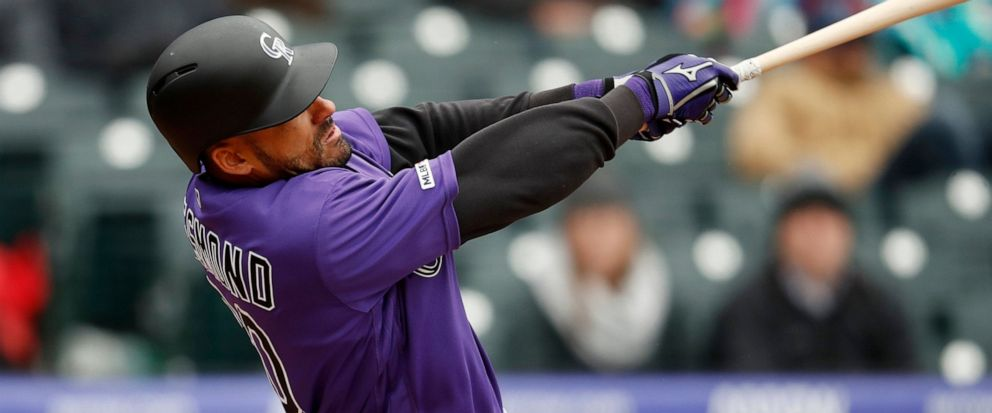 89ae7a4bf88 Rockies rally to beat Giants 12-11 at wintry Coors Field - ABC News