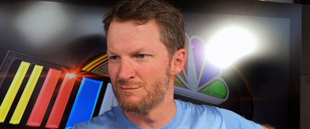 FILE - In this Friday, July 6, 2018 file photo, Dale Earnhardt Jr. goes through an interview during NASCAR auto racing pre-race activities at Daytona International Speedway in Daytona Beach, Fla. NASCAR television analyst and former driver Dale Earnh