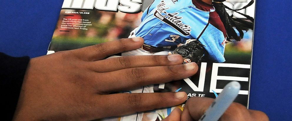 FILE - In this Saturday, Feb. 27, 2016 file photo, Mone Davis, 14, of Philadelphia, signs an autograph for a fan on the cover of Sports Illustrated magazine at PNC Field in Moosic, Pa. Little-known media company Maven, Sports Illustrated's new manag