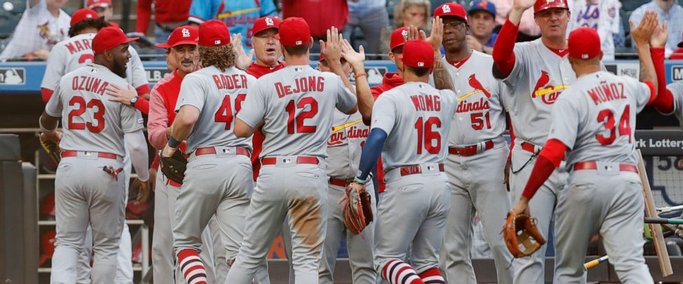 St. Louis Cardinals celebrate on the field after the Cardinals defeated the New York Mets 5-4 in 10 innings Friday, June 14, 2019, in New York in a game that was suspended Thursday because of rain. Paul DeJong (12) drove in Yairo Munoz, right, with t