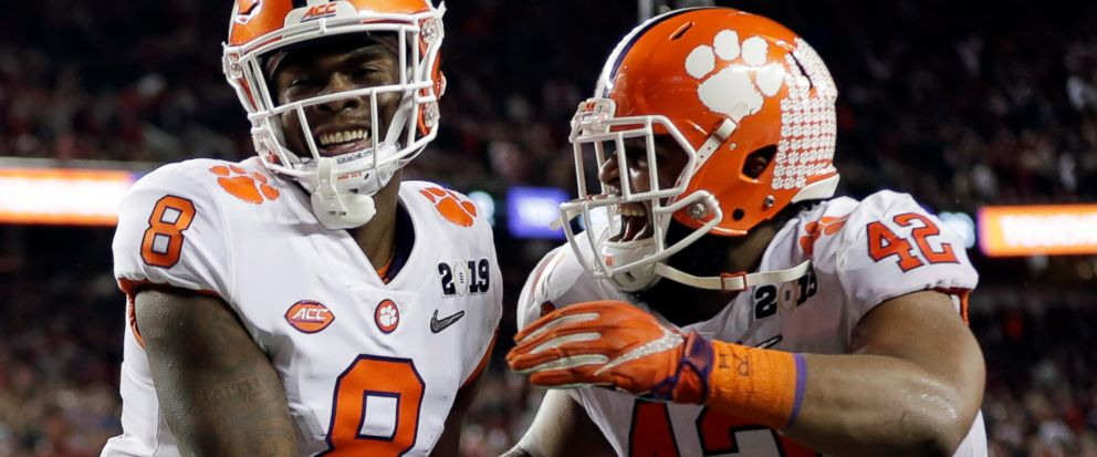 Clemsons Justyn Ross celebrates his touchdown catch with Christian Wilkins (42) during the second half of the NCAA college football playoff championship game against Alabama, Monday, Jan. 7, 2019, in Santa Clara, Calif. (AP Photo/David J. Phillip)