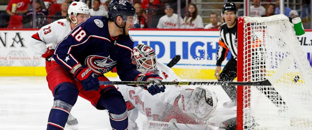 Columbus Blue Jackets Pierre-Luc Dubois (18) gets his shot past Carolina Hurricanes goaltender James Reimer (47) for a goal during the third period of an NHL hockey game in Raleigh, N.C., Saturday, Oct. 12, 2019. (AP Photo/Karl B DeBlaker)