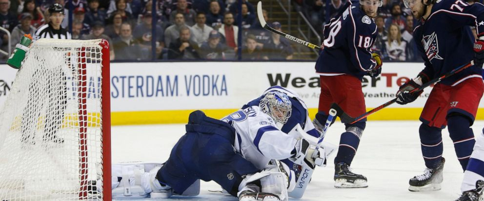 Tampa Bay Lightnings Andrei Vasilevskiy, left, of Russia, gives up a goal as Columbus Blue Jackets Pierre-Luc Dubois, center, and Josh Anderson watch the play during the second period of Game 3 of an NHL hockey first-round playoff series Sunday, Ap