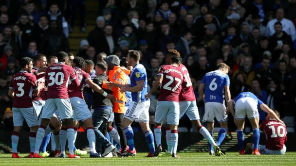 English soccer field invasions see players punched, pushed