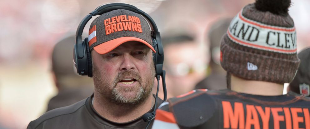 FILE - In this Nov. 4, 2018, file photo, Cleveland Browns offensive coordinator Freddie Kitchens talks to quarterback Baker Mayfield during an NFL football game against the Kansas City Chiefs, in Cleveland. A person familiar with the decision says th